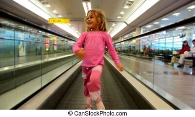 Little girl goes on automatic track in the airport - Little...