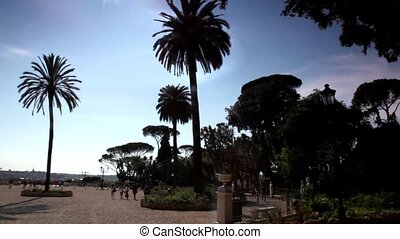Overview of Piazzale Napoleone I, shows plants and people...