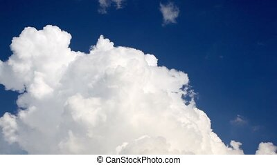 Dense clouds flew in the sky lighted sunshine - Dense clouds...