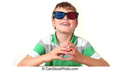 Boy sits in stereo glasses moves fingers and making faces