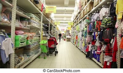 Many children goods are on shelves in store