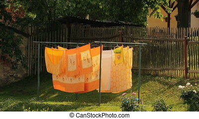 Washed clothes drying outside of an old house