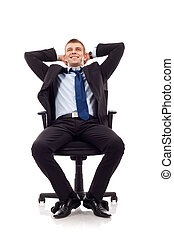 Relaxed businessman sitting in his office chair, leaning...