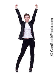 celebrating - Happy business woman with hands raised...