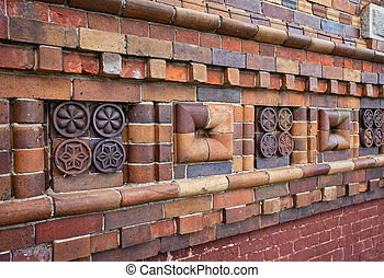 Fragment of old brick walls with patterns