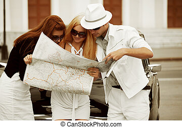 Young tourists with a road map - Young tourists with a map...