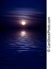Moonrise - Full moon rises over huge body of water, empty...
