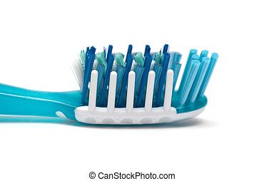 Close up of a blue toothbrush over white background