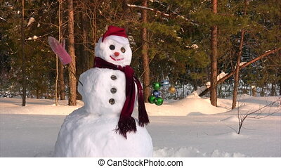 Happy snowman - Winter scene with snowman on forest...
