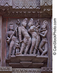 Loving couple: Sculptures on Hindu temple - Servants...