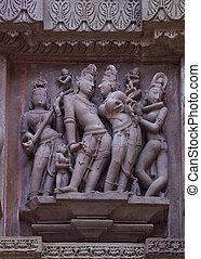 Loving couple: Sculptures on Hindu temple - Servants...