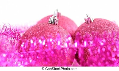 Christmas tree balls rotate, surrounded by tinsel - Three...