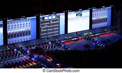 Work behind the modern mixer panel during a concert