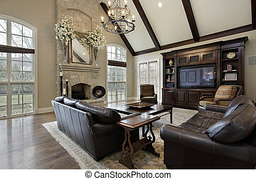 Family room with two story stone fireplace - Family room in...