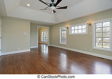 Master bedroom in remodeled home with vaulted ceiling