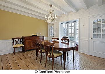 Dining room with white ceiling wood beams