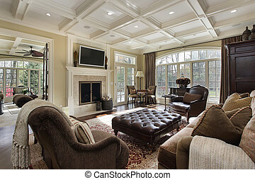Large family room with fireplace and wall of windows