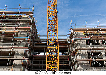 Construction site - Large construction site with scaffolding...