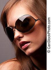 woman wearing glasses - beautiful young woman wearing...