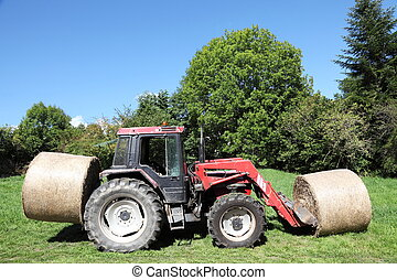 Tractor Loaded With Hay Bales - A tractor loaded with two...