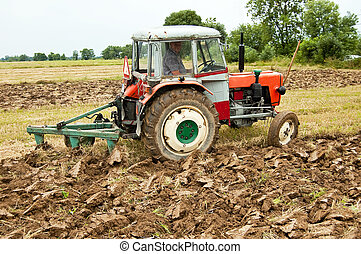 ploughing field on old tractor in southern Poland