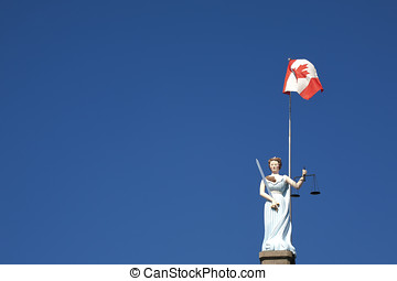 Canadian Justice Statue - A statue of Lady Justice holding...