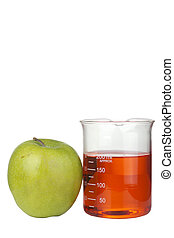 Food Experiment - Green apple and a beaker with red liquid...