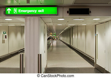 Emergency exit sign - green emergency sign at a...