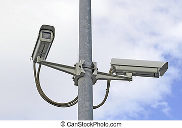 security cameras - two security cameras on a street pole...