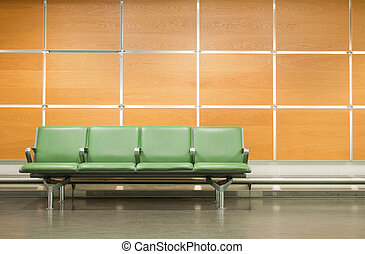 Seats - empty seats at a business building against a wooden...