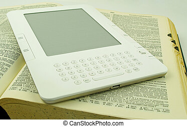 e book and old paper book - white e book on a old open paper...