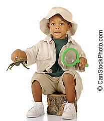 Explorer with Frog - An adorable preschooler sitting on a...