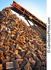 Chopped fire wood ready to be stacked for winter