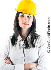 Portrait of a young engineer woman in yellow helmet