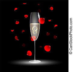 two rings in a glass of champagne - black background with a...