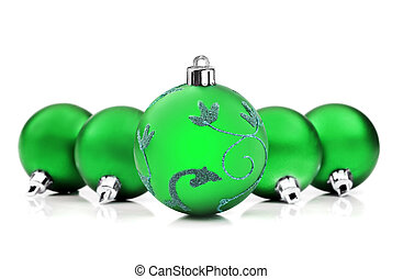 Bright green christmas baubles on white background with space for text