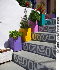 traditional Greek house entrance and flowerpots