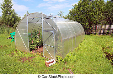 plastic hothouse in rural homestead