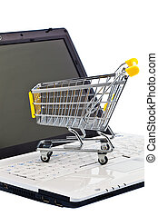 Cart and keyboard Online Shopping - A cart and a computer...