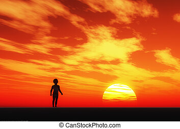 Young boy is watching the sunset