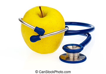 Stethoscope and apple Healthy eating - A stethoscope and an...
