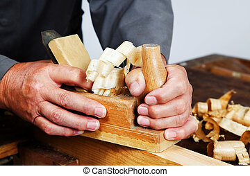 Carpenters with wood - A carpenter with a planer and wood...