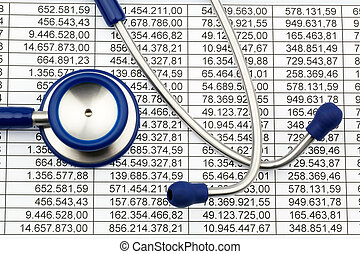 Stethoscope and balance sheet figures - A stethoscope and a...