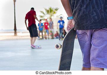 skaters - Several skaters enjoying a skatepark