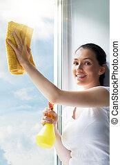 washing windows - young woman washing windows
