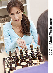 Beautiful Woman Playing Chess With Her Husband