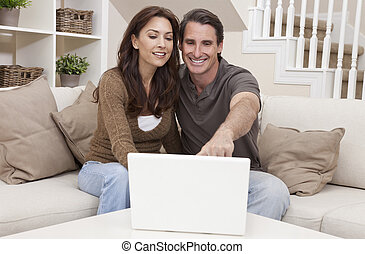 Happy Middle Aged Man and Woman Couple Using Laptop Computer...