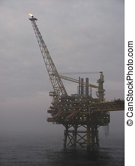 Oil rig in mist - A North Sea oil rig on a misty day