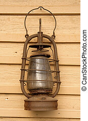 The old kerosene lamp hanging on the wall of a village house