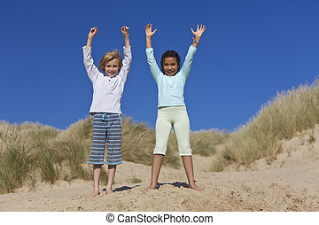 Happy Children, Boy and Girl, Playing At Beach - Mixed race...
